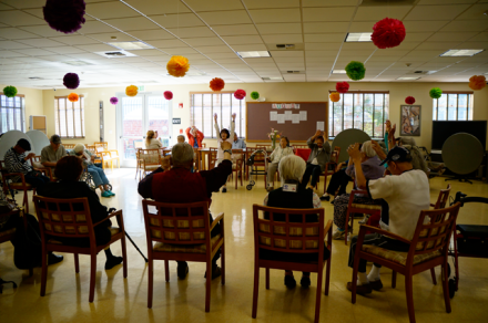 Seniors exercising at the Mark S. Taper Adult Day Health Center at St. Barnabas Senior Services. Photo by: Tammy Nguyen