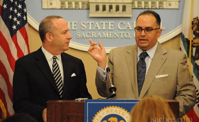 HECTOR AMEZCUA/hamezcua@sacbee.com Senate President Pro Tem Darrell Steinberg, D-Sacramento, listens to Assembly Speaker John A. Perez, D-Los Angeles, during a news conference on the state budget in the state Capitol in Sacramento on Wednesday. Read more here: http://www.sacbee.com/2012/08/24/4753370_a4559631/use-it-or-lose-it-budget-practice.html#storylink=cpy
