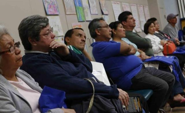 People attend an orientation in North Hills last February for Covered California and Medi-Cal enrollees. (Los Angeles Times)
